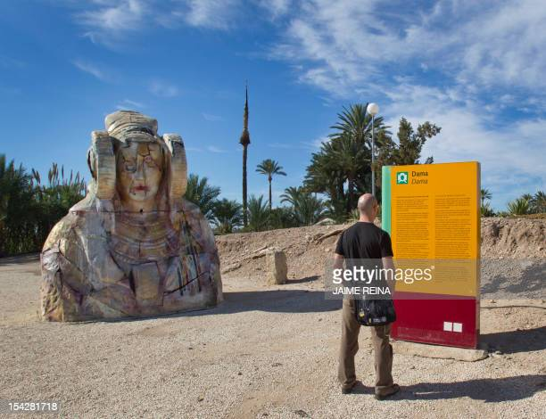 A man look at a replica of the stone bust of the Lady of Elche in Elche southeast Spain on October 17 AFP PHOTO/ Jaime REINA