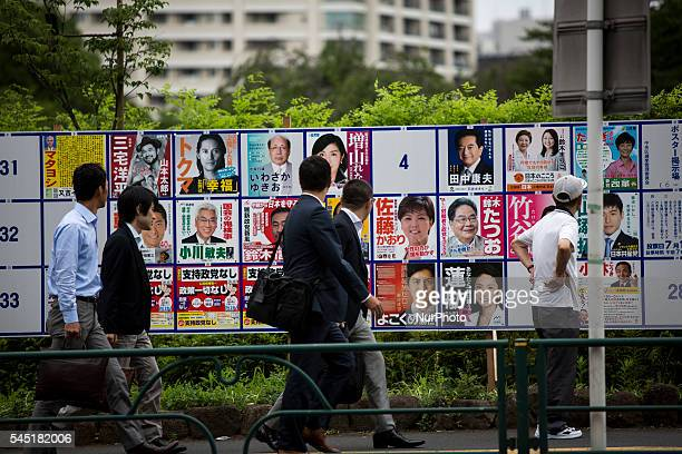 A man look at campaign posters with pictures of candidates for the 2016 Upper House election in Tokyo Japan on Tuesday July 5 2016 Japanese voters...