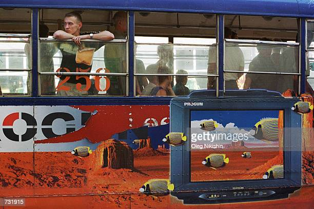 A man look out the window of a tram September 10 2000 in downtown Vladivostok Russian Far East