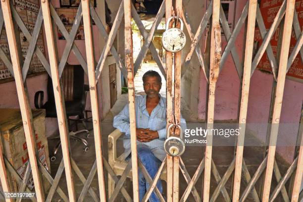 A man look outside from his house main gate during the Lockdown imposed in the wake of the deadly novel coronavirus pandemic in Jaipur RajasthanIndia...