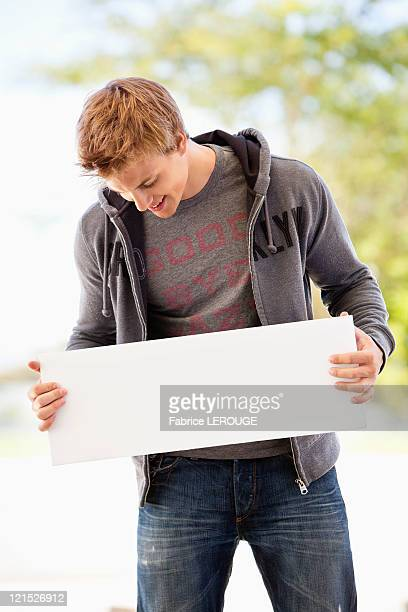 Man looking at a blank placard