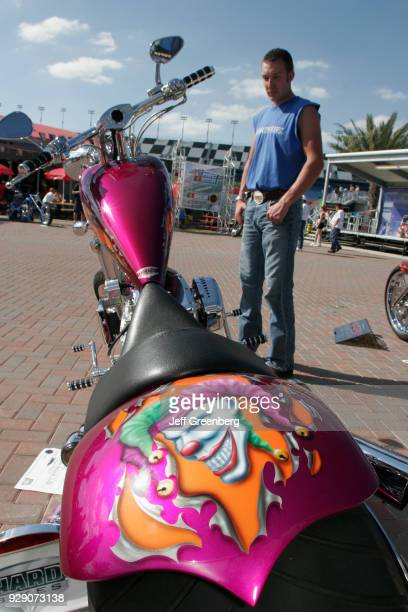 A man looking at a customized bike in the Fan Zone on the International Speedway at Daytona Beach