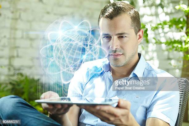 Man looking at a scientific globe projection