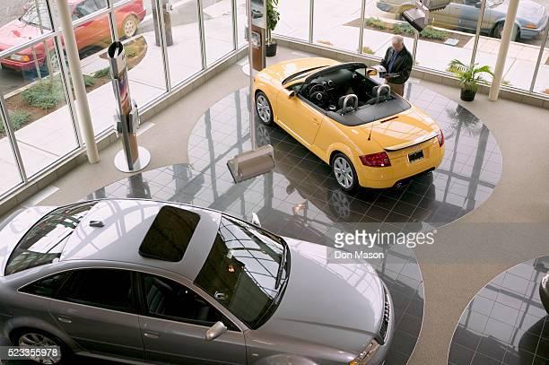 man looking at an audi convertible - car dealership stock pictures, royalty-free photos & images