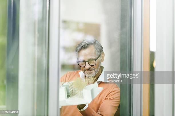 Man looking at architectural model