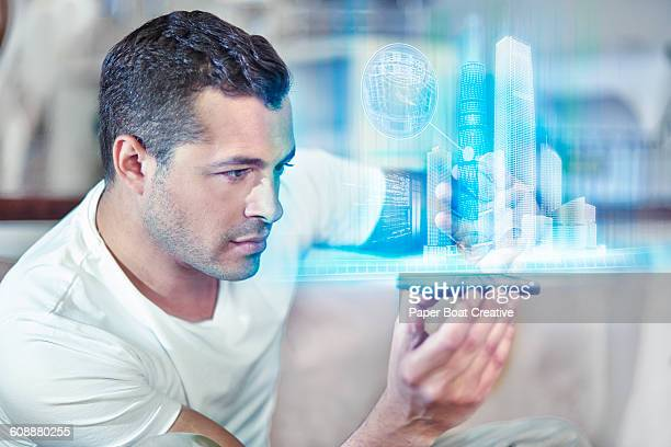 Man looking at architectural sculpture on phone