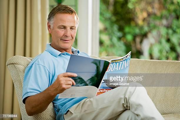 Man looking at boating magazine