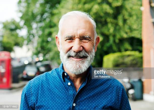 man looking at camera, smiling - human face stock pictures, royalty-free photos & images