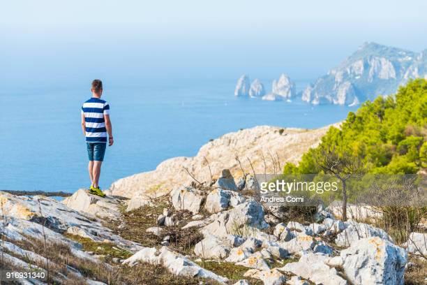 Man looking at Capri island