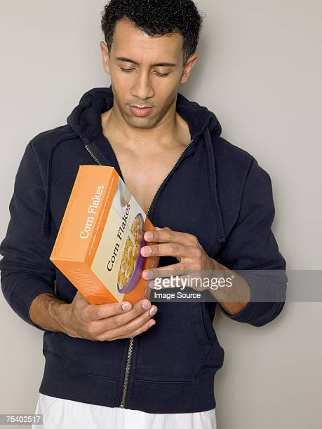 Man looking at cereal packet