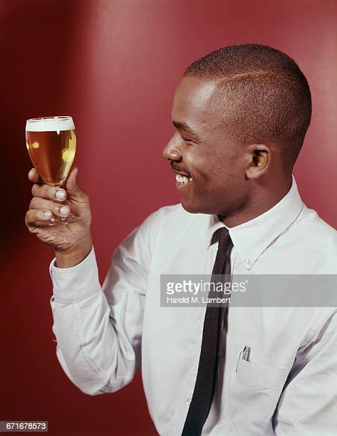 """man looking at champagne glass, close-up "" - neckwear stock pictures, royalty-free photos & images"