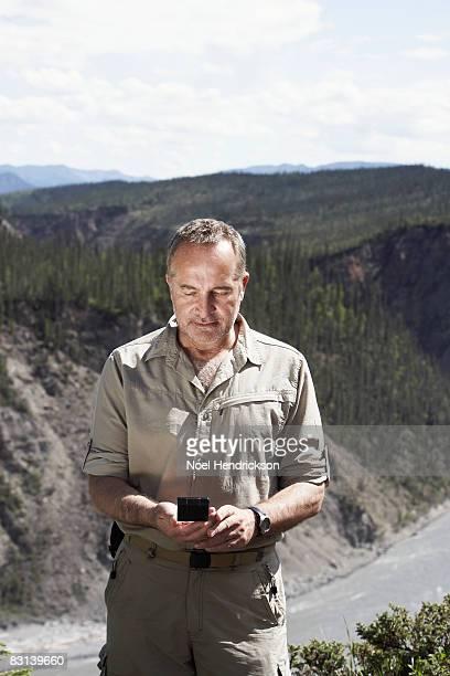 man looking at compass outdoors