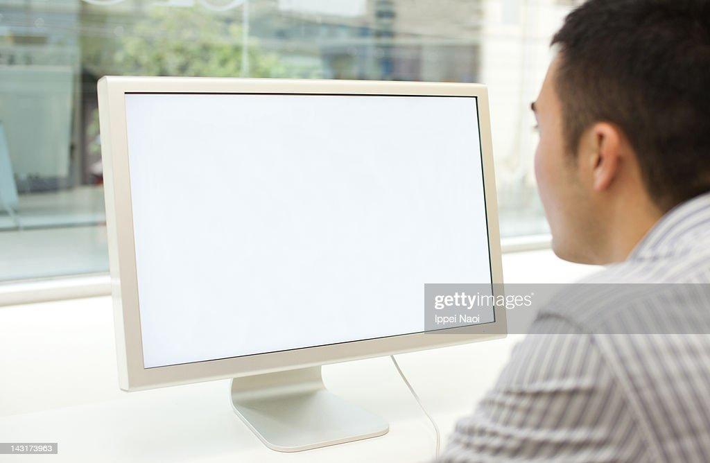 Man looking at computer screen : Stock Photo
