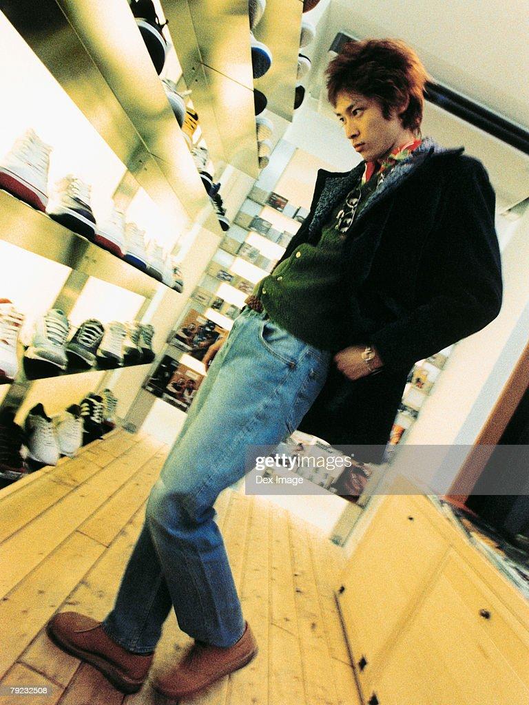 Man looking at display of shoes : Stock Photo
