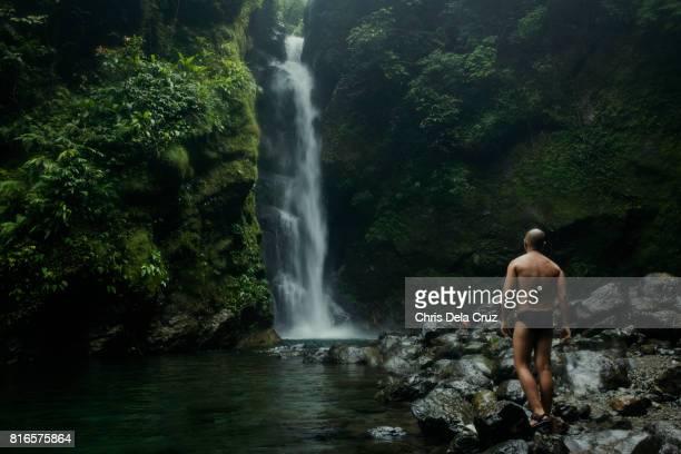Man looking at Ditumabo Falls