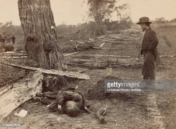 Man Looking at Grave of 1st Lt. John A. Clark, Company D, 7th Michigan Infantry, as Dead Rebel Soldier lies Nearby, Battle of Antietam, Antietam,...