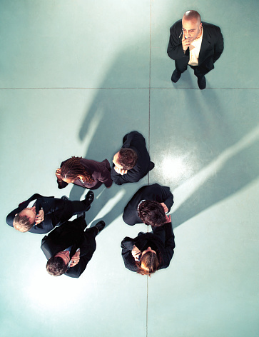 Man looking at group of business people in circle, overhead view - gettyimageskorea
