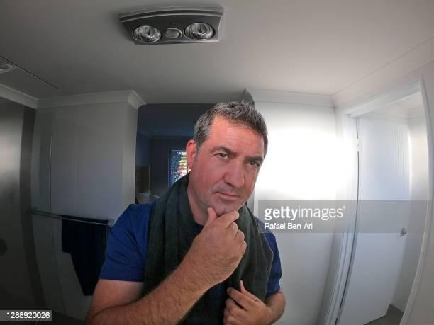 man looking at himself in mirror - rafael ben ari bildbanksfoton och bilder
