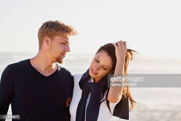 Man looking at his girlfriend on beach
