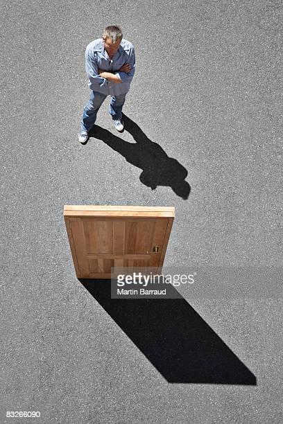 Man looking at isolated door