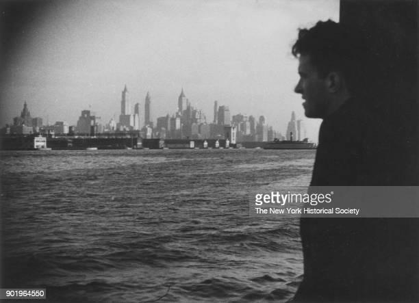 Man looking at Manhattan skyline from boat, New York, New York, 1929.