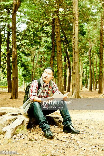 Man looking at map in forest