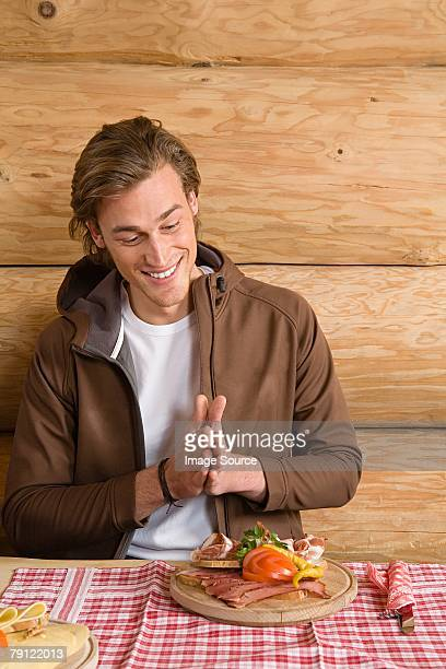 Man looking at meal