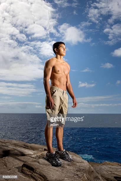 Man looking at ocean, Hawaii