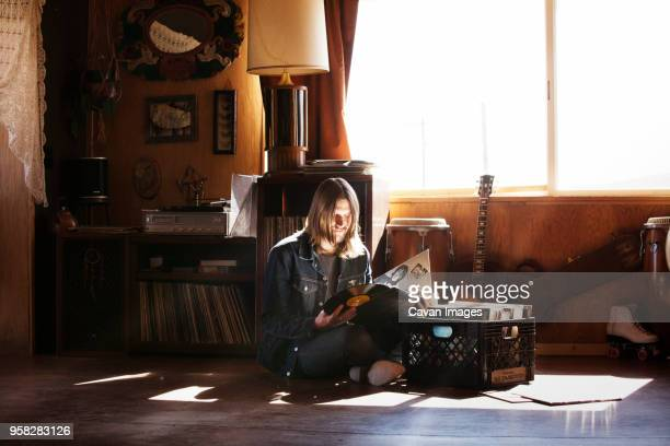 man looking at records while sitting at home - collection stock pictures, royalty-free photos & images