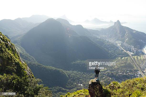man looking at rio de janeiro from above - brazilian men stock photos and pictures