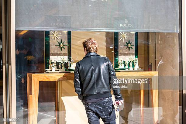 Man looking at Rolex window display on Rodeo Drive