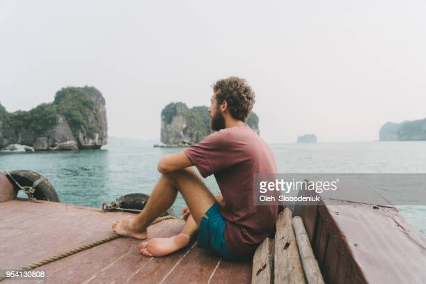 Man looking at scenic view of Halong Bay from the boat