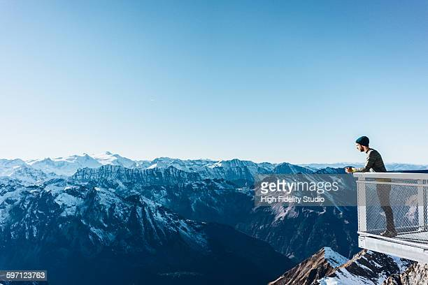 man looking at scenic view of kitzsteinhorn - panorama stock-fotos und bilder