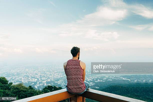 Man looking at scenic view of valley
