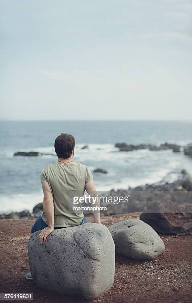 A man looking at sea