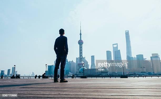Man looking at Shanghai skyline