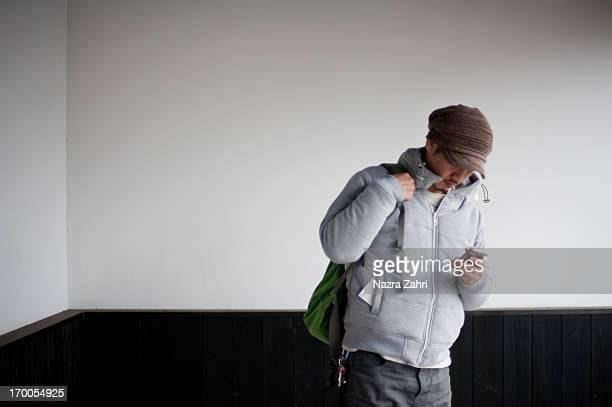 Man looking at smartphone while waiting