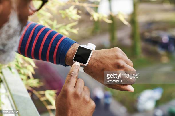 man looking at smartwatch - smart watch stock pictures, royalty-free photos & images