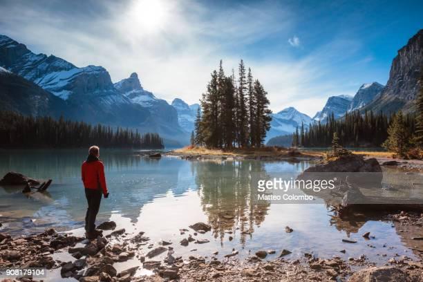 Man looking at Spirit Island, Maligne lake, Canada
