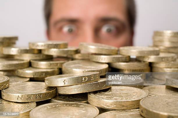 Man looking at stack of coins