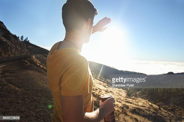 Man looking at sunset in mountains