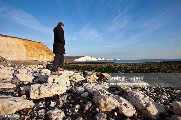 Man looking at Sussex coastline