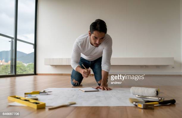 Man looking at the blueprints of his new house