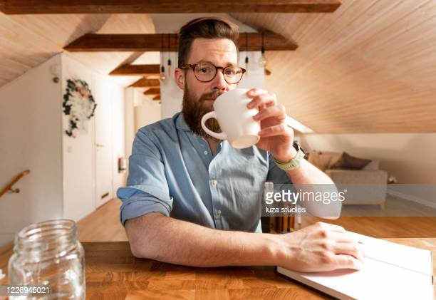 man looking at the camera in a video conference call - looking at camera stock pictures, royalty-free photos & images