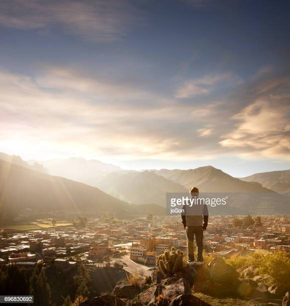 Man looking at the city of  Yanque at the base of the Andes Mountain