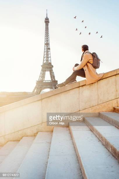 Man looking at the Eiffel Tower in Paris