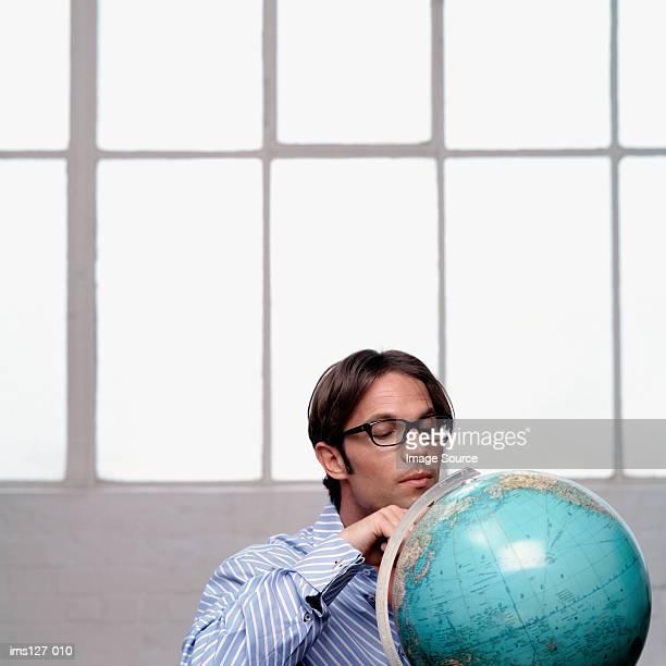 Man looking at the globe