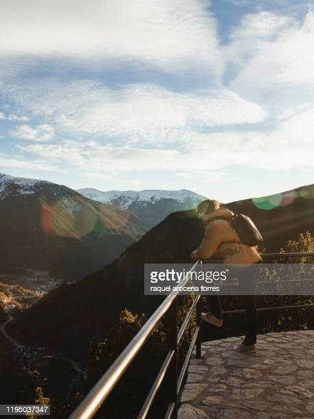 man looking at the mountains landscape - andorra fotografías e imágenes de stock