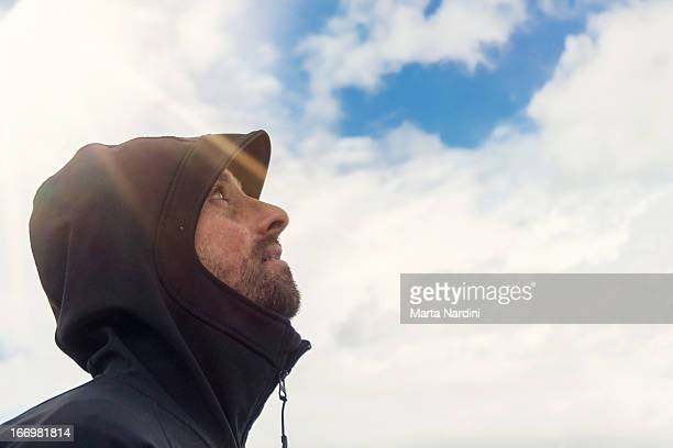 Man looking at the sky with sunshine