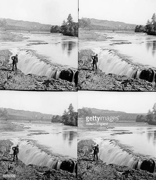 A man looking at the waterfall on the Passaic River near Paterson New Jersey